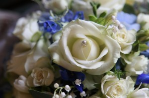 Wedding bouquet with cream and sapphire blue flowers