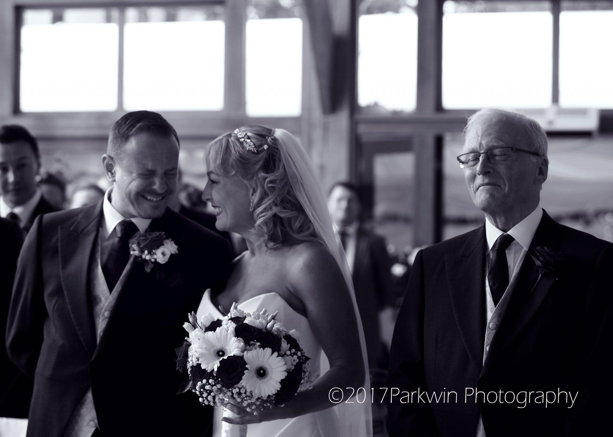Groom seeing bride at Brocket Hall and proud Dad.