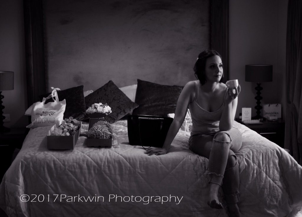 Bridesmaids having a quiet moment before getting ready