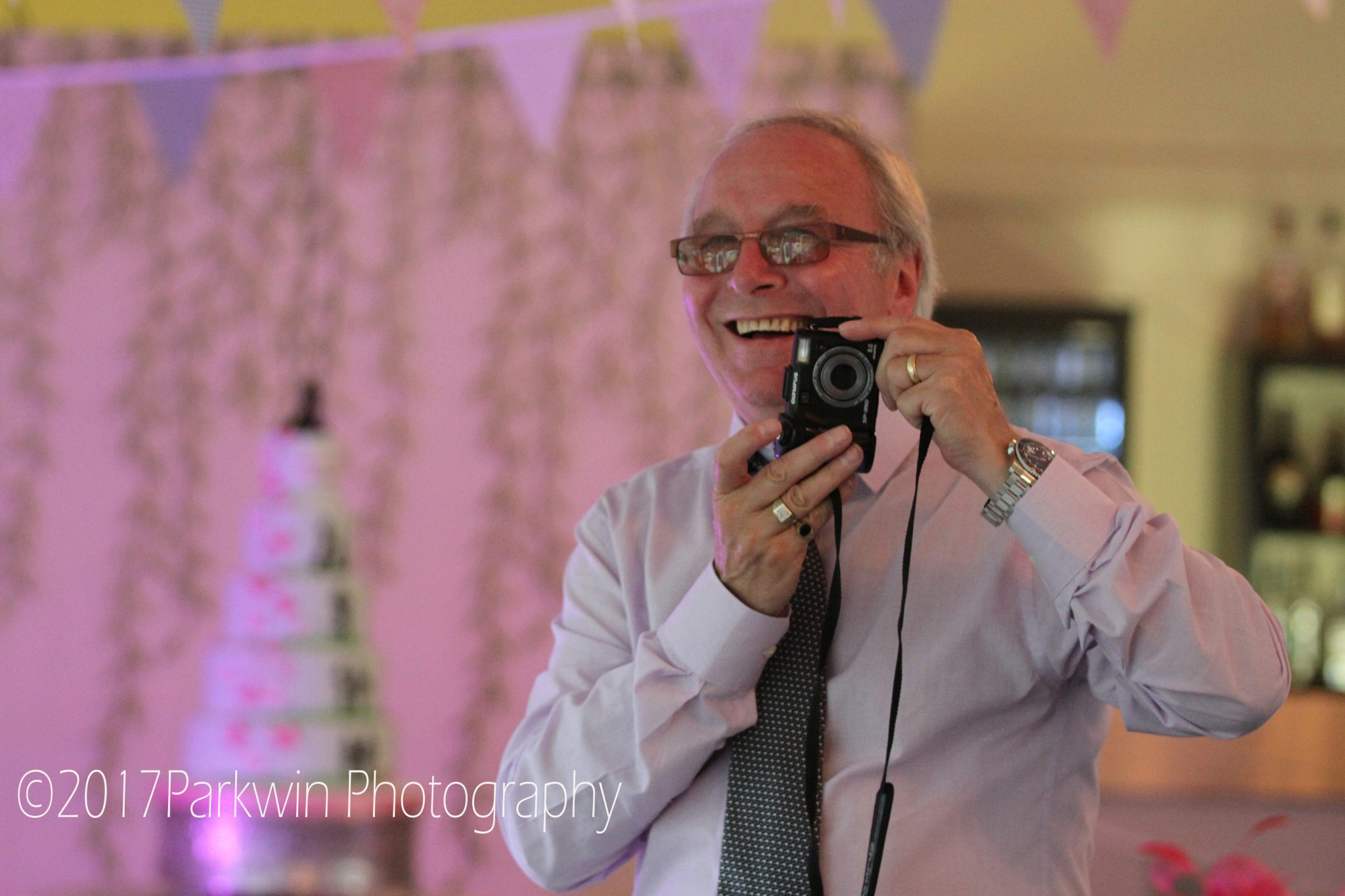 Guest taking photo at Hunton Park wedding